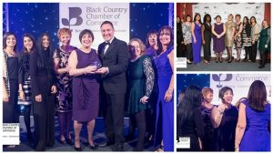 A picture of a group of women in evening dress holding an award at the Black Country Chamber of Commerce Awards