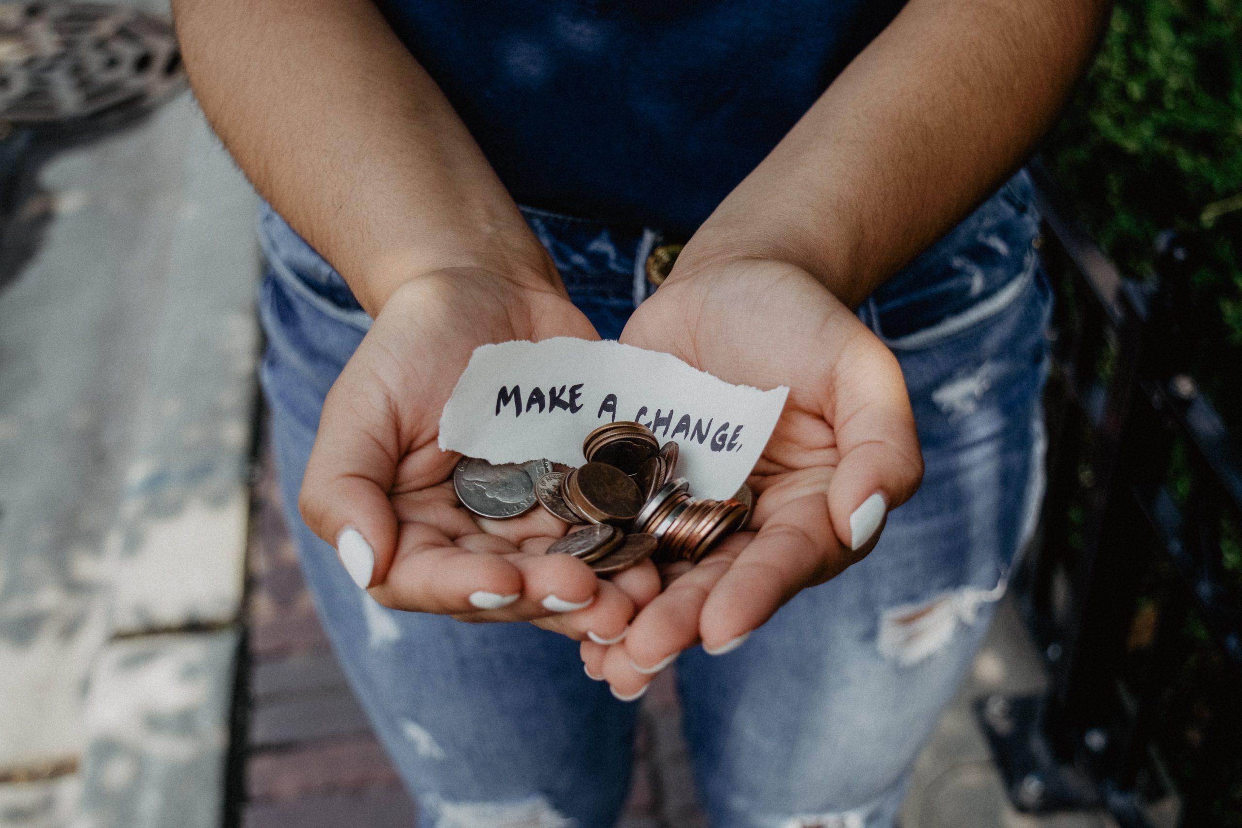 a woman's hands holding money